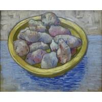 Still life potatoes in a yellow dish